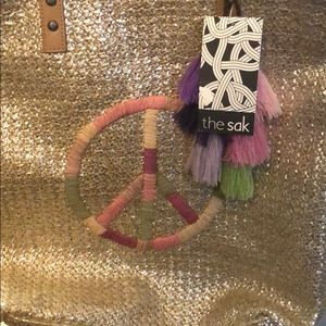 NWT The Sak Gold Straw Peace Sign Tasseled Tote